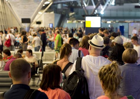 Why do people crowd airport boarding gates